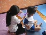 yoga kids helping each other